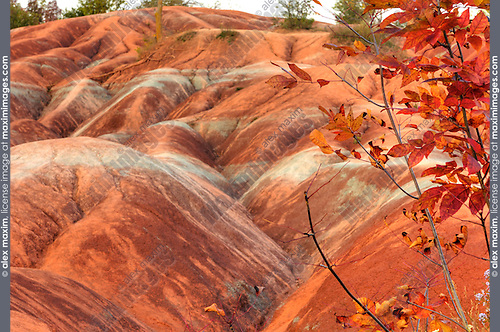 Gorgeous Martian like landscape formed from red and gray eroded clay. Cheltenham Badlands Ontario Canada HDR image