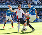 Lee Wallace tries to turn past Mark Kerr