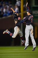 Cleveland Indians shortstop Francisco Lindor (12) high fives Lonnie Chisenhall (8) after closing out Game 3 of the Major League Baseball World Series against the Chicago Cubs on October 28, 2016 at Wrigley Field in Chicago, Illinois.  (Mike Janes/Four Seam Images)