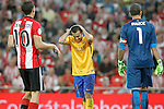 FC Barcelona's Pedro Rodriguez dejected in presence of Athletic de Bilbao's Oscar de Marcos (l) and Gorka Iraizoz during Supercup of Spain 1st match.August 14,2015. (ALTERPHOTOS/Acero)