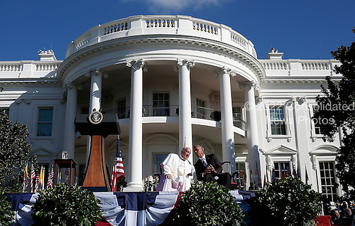 U.S. President Barack Obama (R) speaks with Pope Francis (L) during an arrival ceremony at the White House on September 23, 2015 in Washington, DC. The Pope begins his first trip to the United States at the White House followed by a visit to St. Matthew's Cathedral, and will then hold a Mass on the grounds of the Basilica of the National Shrine of the Immaculate Conception.  <br /> Credit: Win McNamee / Pool via CNP