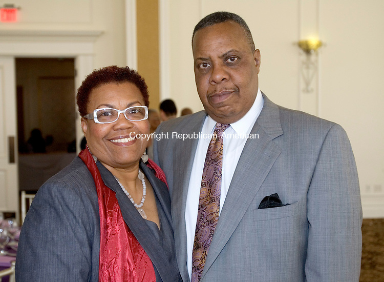 PROSPECT CT. 03 May 2014-050317SV16-From left, Evelyn and Ronny Knight of Waterbury attend The Greater Waterbury Chapter of the National Congress of Black Women, Inc. Scholarship Luncheon at Aria Wedding and Banquet Facility in Prospect Saturday. <br /> Steven Valenti Republican-American
