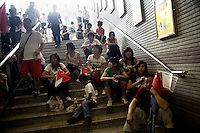 Spectators crowd a Nanjing Metro station waiting for their turn to take a subway after the completion of the southern portion of the Nanjing, China, leg of the 2008 Olympic Torch Relay.  .