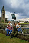 Duke of Westminster. 1990s at Eaton Hall which is the white modern building in background. Chapel Tower on right The old family home on the left. With wife, Natalia Ayesha, and daughters  Edwina and Tamara Grosvenor,