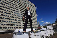 "Joel Hemesley in a suit on the hives of the Royal Lancaster Hotel.  Just a stone's throw from Hyde Park, the hotel's bees have been gathering honey from the flowers in the royal gardens. Joel joined the hotel's green team, which takes of the hives, the idea being to produce local honey to serve to guests but also to help the bees survive. ""With the help of our mentor, Luke Dixon, fives hives were set up in the summer of 2009 and today we have ten. My work at the hotel is no picnic: I'm part of the managing team and I handle corporate sales to foreign companies and I travel a lot. My first encounter with bees occurred in school when I was twelve years old. At that time, in the context of the Duke of Edinburgh's program, we were supposed learn a trade and I chose apiculture. I hadn't reopened a hive until we put into place the hives at the hotel. Bees are really fascinating creatures. I love the way the life is organized around the colony. Each bee has a role to play in the population's survival and I love feeling that harmony."