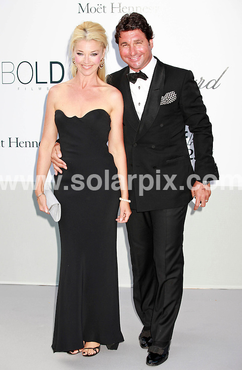 **ALL ROUND PICTURES FROM SOLARPIX.COM**                                             **UK AND SPAIN SYNDICATION RIGHTS ONLY**                                                                                  Caption: Arrivals at the amfAR Cinema against AIDS gala during the 64th Cannes Film Festival, Antibes, France. 19 May 2011                                                                              This pic: Tamara Beckwith, Giorgio Veroni                                                                                              JOB REF: 13385 CPR       DATE: 19_05_2011                                                           **MUST CREDIT SOLARPIX.COM OR DOUBLE FEE WILL BE CHARGED**                                                                      **MUST AGREE FEE BEFORE ONLINE USAGE**                               **CALL US ON: +34 952 811 768 or LOW RATE FROM UK 0844 617 7637**