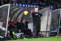 Crawley Town Manager Dermot Drummy kicks the ball during the Sky Bet League 2 match between Wycombe Wanderers and Crawley Town at Adams Park, High Wycombe, England on 25 February 2017. Photo by Andy Rowland / PRiME Media Images.