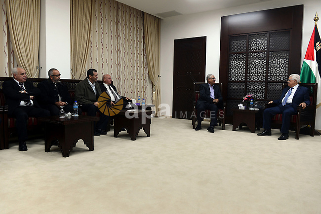 Palestinian President Mahmoud Abbas meets with the Chairman of the Arab Monitoring Committee Mazen Ghanaim, in the West Bank city of Ramallah, December 14, 2014. Photo by Thaer Ganaim