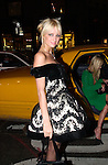 Paris Hilton and Nicky Hilton  arrive at a benefit in Manhattan on October 17, 2001 by taxi.