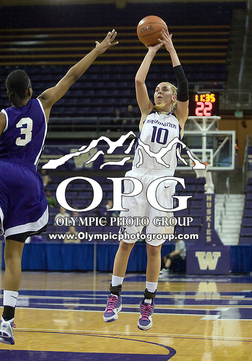 17 March 2010:  Washington Huskies guard #10 Kristi Kingma shoots a jumper against Portland. Washington won 75-44 over Portland during the first round of the Women's Basketball Invitational at the Bank of America Arena in Seattle, WA.