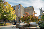 Students walk to and from class on a crisp, Fall day outside Perkins Library, beside Duke Chapel, on West Campus.