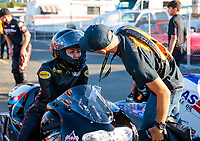 Jul 26, 2019; Sonoma, CA, USA; NHRA pro stock motorcycle rider Jianna Salinas with crew members during qualifying for the Sonoma Nationals at Sonoma Raceway. Mandatory Credit: Mark J. Rebilas-USA TODAY Sports