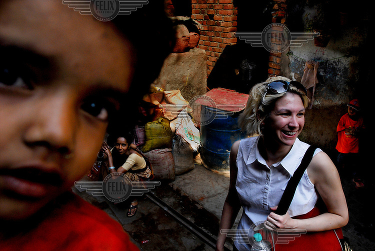An MBA Student from an American business school interacts with locals in Dharavi on an organised tour of the slum.