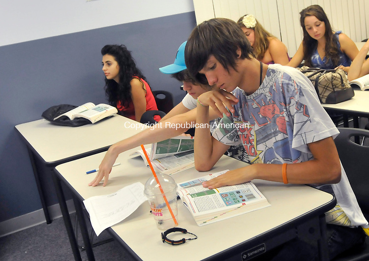 WATERTOWN, CT-28 JULY 2010-072810IP05- (l to r) Ashley Mancini, 16, of Watertown, Josh Arcangeli, 16, of Thomaston, and Ian McConnell, 16, of Bethlehem, listen during a driving class at All-Star Driver school in Watertown on Wednesday. The number of teens getting their driver licenses is down nationwide and in Connecticut.<br /> Irena Pastorello Republican-American