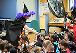Staff member Moira Corbett giving out treats to the children at the Clare Champion Halloween Party for Ennis NS and Holy family school children. Photograph by John Kelly.