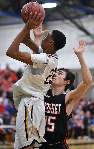 Craig Brown #22 of Uniondale shoots from short range as James Dionisio #25 of Syosset guards him during the Nassau County varsity boys basketball Class AA semifinals at SUNY Old Westbury on Tuesday, Feb. 28, 2017. Brown scored 17 points in Uniondale's 69-44 win.