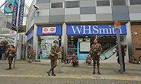 Men in World War I gear outside the Quadrant shopping centre, Swansea, south Wales UK. Friday 01 July 2016