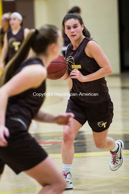 THOMASTON, CT- 30 November 2015-113015EC05-   Thomaston's Nicole Schaefer runs a drill Monday, the first day of practice for the Golden Bears. Erin Covey Republican-American