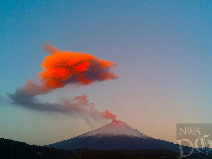 A plume of ash and steam rises from the crater of the Popocatepetl volcano as seen from the town of San Nicolas de los Ranchos, Mexico, early Wednesday, March 25, 2015. During the last 24 hours, activity at the volcano has increased moderately but the alert level remains unchanged. (AP Photo/Dario Lopez-Mills)