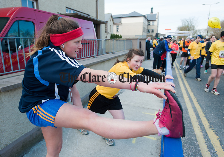 Clarecastle's Samara O Callaghan and Caoimhe Morrissey of Ballyea  limber out before the Eamon Moloney 10 K memorial Run4Life race  in aid of the Clare Cancer Support Centre in Kilnamona. Photograph by John Kelly