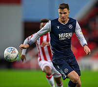 11th January 2020; Bet365 Stadium, Stoke, Staffordshire, England; English Championship Football, Stoke City versus Milwall FC; Jake Cooper of Millwall with his eye on the ball - Strictly Editorial Use Only. No use with unauthorized audio, video, data, fixture lists, club/league logos or 'live' services. Online in-match use limited to 120 images, no video emulation. No use in betting, games or single club/league/player publications