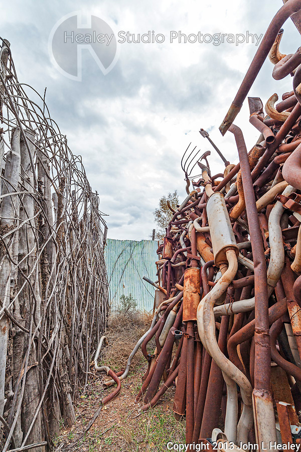Americana Series: Roadside Views<br /> <br /> Found art landscape created by a rustic fence and roadside sculpture.