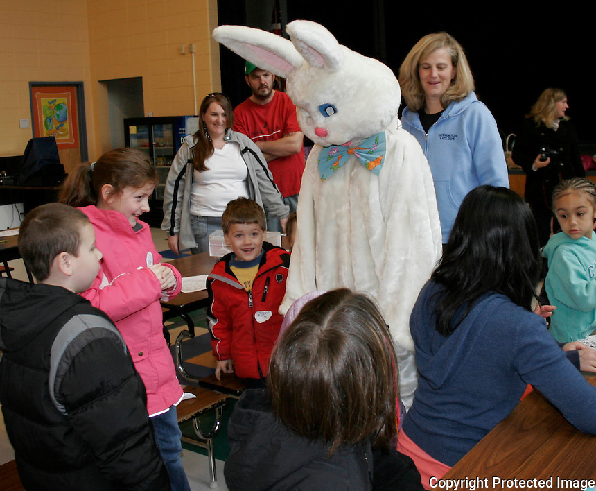 Easter Egg hunters meet the Easter Bunny at The Raynham Park and Recreation Department Annual Easter Easter_Egg Hunt, Saturday March 31, 2012 at the LaLiberte Elementary School in Raynham.(Photo by Gary Wilcox)