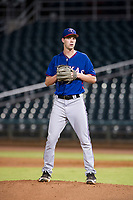 AZL Rangers relief pitcher Ryan Dease (19) checks a runner at third base before delivering a pitch to the plate against the AZL Indians on August 26, 2017 at Goodyear Ball Park in Goodyear, Arizona. AZL Indians defeated the AZL Rangers 5-3. (Zachary Lucy/Four Seam Images)