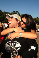 Mar. 13, 2011; Gainesville, FL, USA; NHRA top fuel dragster driver Del Worsham is congratulated by wife Connie Worsham after winning the Gatornationals at Gainesville Raceway. Mandatory Credit: Mark J. Rebilas-