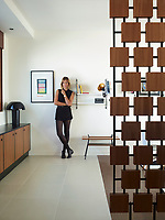 A portrait of interior designer, Florence Deau, in one of the apartments of an Yves Salier building that she has been transforming.