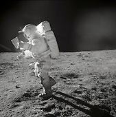 Astronaut Edgar D. Mitchell, Apollo 14 Lunar Module pilot, moves across the lunar surface as he looks over a traverse map during extravehicular activity (EVA) on February 6, 1971. Lunar dust can be seen clinging to the boots and legs of the space suit.<br /> Mandatory Credit: Alan B. Shepard / NASA via CNP