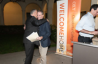 Coach Brian Newhall '83<br /> Ethan Caldwell '90<br /> John Pike '96<br /> Now in his 30th year as Oxy's head men's basketball coach, Brian Newhall received a much deserved celebration with a surprise halftime ceremony and post game reception in the Booth Hall courtyard with more than 70 former and current players from all different generations and decades in attendance, on Saturday, Jan. 26, 2019.<br /> Newhall is the winningest coach in Oxy history and has a 100 percent graduation rate in his 30 years at the helm of the program. His resume boasts multiple SCIAC Championships and NCAA Playoff appearances, along with a run to the NCAA Division III Elite Eight in 2003 and the only perfect 14-0 season in SCIAC history. Newhall has not only coached at Oxy, but was a SCIAC Champion and SCIAC Player of the Year during his playing career at Oxy in the early 80s.<br /> (Photo by Marc Campos, Occidental College Photographer)