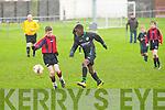 Kingdom Boys Kevin Williams and Mastergeeha FC's Denis O'Connor.