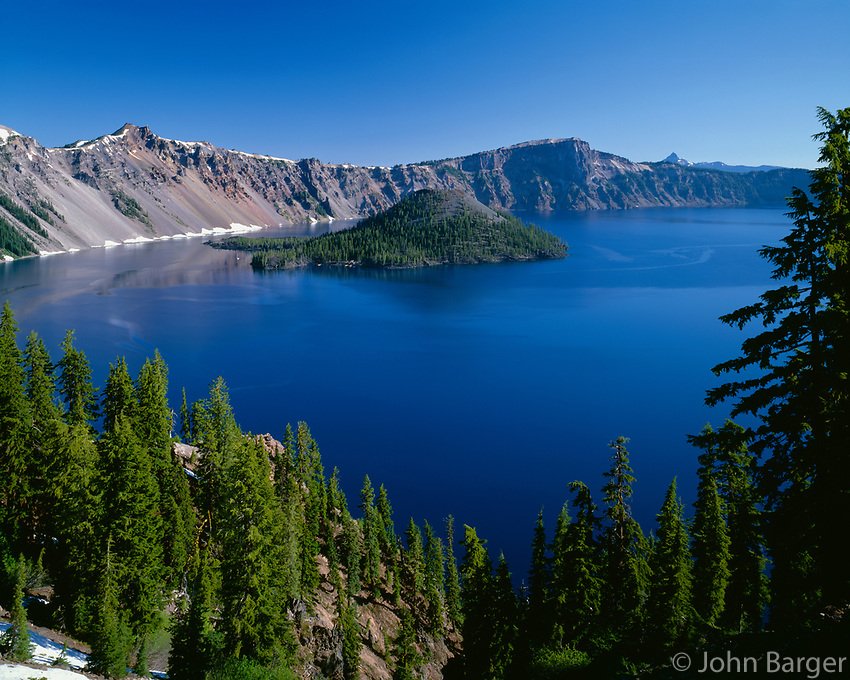 ORCL_034 - USA, Oregon, Crater Lake National Park, Wizard Island and Crater Lake with a grove of mountain hemlock on the south rim descending towards the lake.