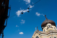 Sneakers hang from a cable outside the Greek Orthodox Church, Williamsburg Brooklyn, New York.
