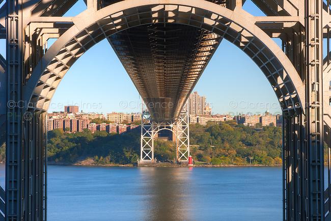 Underneath the George Washington Bridge with Jeffrey's Hook Lighthouse across the Hudson River.