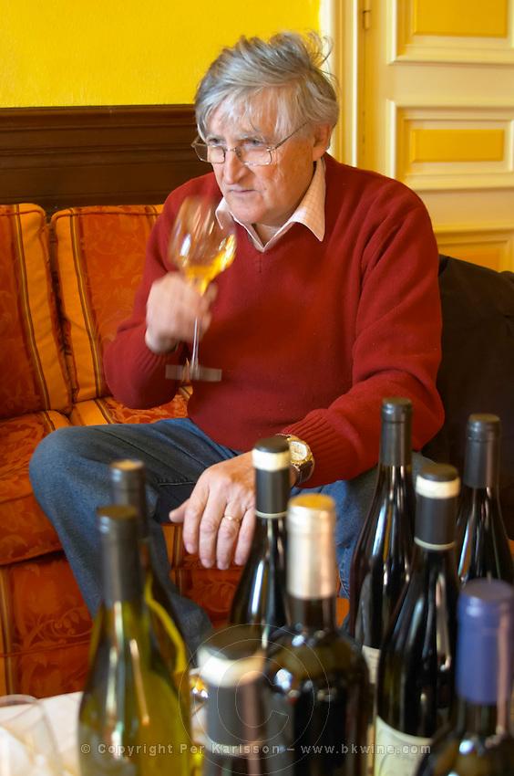 Bernard Jany Chateau la Condamine Bertrand. Chateau la Condamine Bertrand. Pezenas region. Languedoc. Owner winemaker. Tasting wine. France. Europe. Bottle. Wine glass.