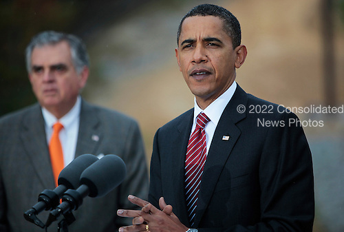 Fairfax County, VA - October 14, 2009 -- United States President Barack Obama delivers remarks on the economic benefits of the Recovery Act after a tour of the Fairfax County Parkway Extension project, the largest Recovery Act project in Virginia, with U.S. Secretary of Transportation Ray LaHood (L), Wednesday, October 14, 2009, Fairfax County, Virginia..Credit: Aude Guerrucci / Pool via CNP