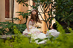 A Bride Poses For Her Wedding Photographs At Our Lady Of Lourdes Church, Shamian, Guangzhou, China.