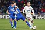 Getafe CF's Angel Rodriguez (l) and Mauro Arambarri (c) and FC Krasnodar's Yuri Gazinski during UEFA Europa League match. December 12,2019. (ALTERPHOTOS/Acero)