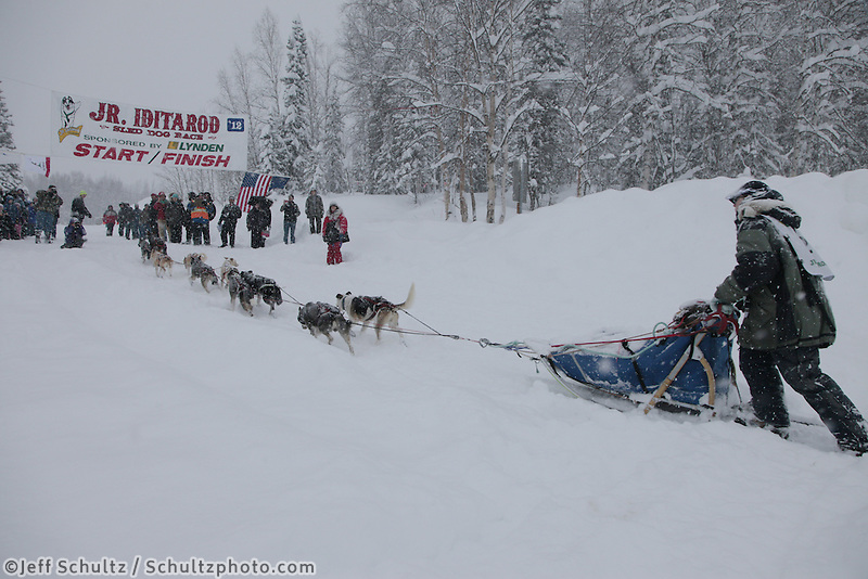 Sunday February 26, 2012  Ben Harper runs up the bank off of Willow Lake to take third place in the 2012 Junior Iditarod.