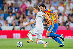Luka Modric (l) of Real Madrid competes for the ball with Daniel Parejo Munoz of Valencia CF during their La Liga 2017-18 match between Real Madrid and Valencia CF at the Estadio Santiago Bernabeu on 27 August 2017 in Madrid, Spain. Photo by Diego Gonzalez / Power Sport Images