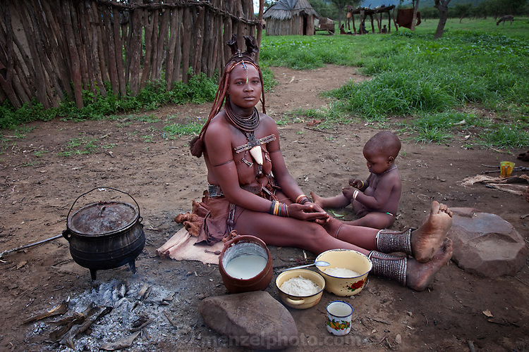 Viahondjera Musutua, a Himba tribeswoman, sits outside the house at her father's village with her youngest son and her typical day's worth of food. (From the book What I Eat: Around the World in 80 Diets.)  Model Released.