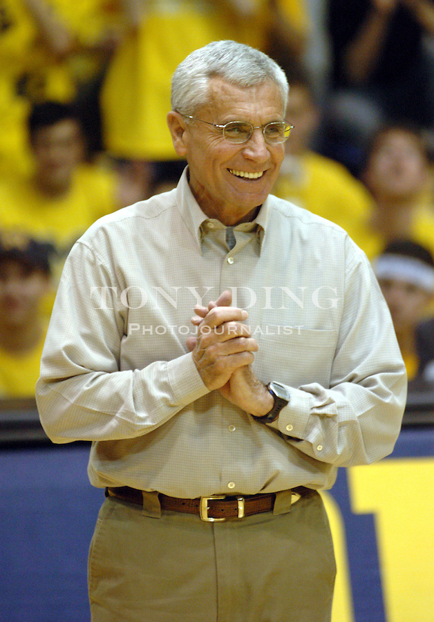 Michigan retiring swimming head coach Jon Urbanchek was honored during the Wolverines' 71-59 upset of the No. 12 ranked Wisconsin Badgers on Sunday, February 22, 2004 at Crisler Arena in Ann Arbor, Mich. (TONY DING / The Michigan Daily)