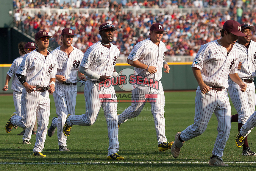 Mississippi State Bulldogs players jog to their dugout before Game 1 of the 2013 Men's College World Series Finals against the UCLA Bruins on June 24, 2013 at TD Ameritrade Park in Omaha, Nebraska. The Bruins defeated the Bulldogs 3-1, taking a 1-0 lead in the best of 3 series. (Andrew Woolley/Four Seam Images)
