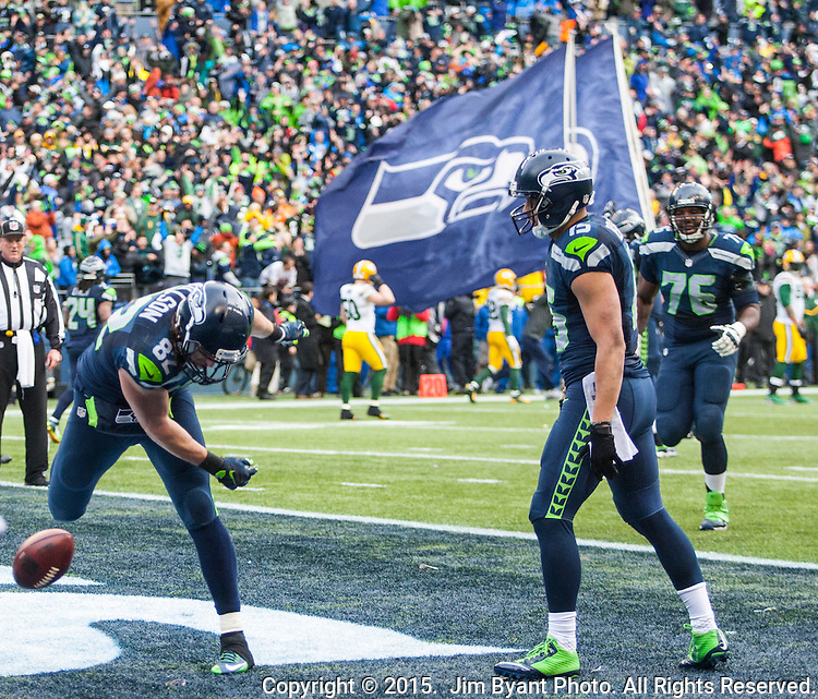 Seattle Seahawks tight end Luke Willson (82) prepares to spike the ball after catching a two-point conservation against the Green Bay Packers  safety Ha Ha Clinton-Dix (21) during the NFC Championship game at CenturyLink Field in Seattle, Washington on January 18, 2015.  The Seattle Seahawks beat the Green Bay Packers in overtime 28-22 for the NFC Championship Seattle.  ©2015. Photo by Jim Bryant. All Rights Reserved