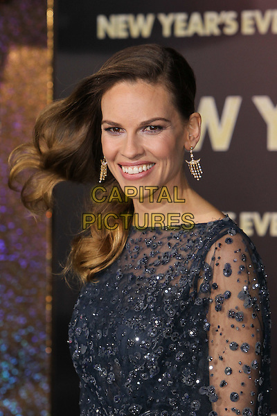 "Hilary Swank.The World Premiere of ""New Year's Eve' held at The Grauman's Chinese Theatre in Hollywood, California, USA..December 5th, 2011.headshot portrait black blue sheer beads beaded dangling gold earrings hair.CAP/CEL .©CelPh/Capital Pictures."