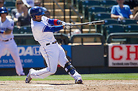 Round Rock designated hitter Robinson Chirinos (14) swings the bat against the Nashville Sounds in the Pacific Coast League baseball game on May 5, 2013 at the Dell Diamond in Round Rock, Texas. Round Rock defeated Nashville 5-1. (Andrew Woolley/Four Seam Images).