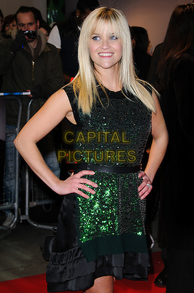 Reese Witherspoon.Arrivals to 'This Means War' UK premiere held at the Odeon, Kensington, London, England..January 30th, 2012.half length dress green sleeveless beads beaded sequins sequined black belt shoes layered layers hands on hips.CAP/CJ.©Chris Joseph/Capital Pictures.