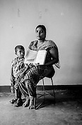 25 year old Rajmohan Srishanthi poses for  photo with her son and CHDR- Child Health Development Record Card (immunization/vaccination card) in Punaineeravi Village in Kilonochchi, Sri Lanka.  Photo: Sanjit Das/Panos